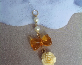 Yellow Bow with a Cabochon Flower and White Pearl beads,Dust plug, Dust Plug Charm, cell phone charm, head phone jack charm, Ipad Charm.