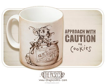 A lovely new mug with some wise words about caution and cookies...