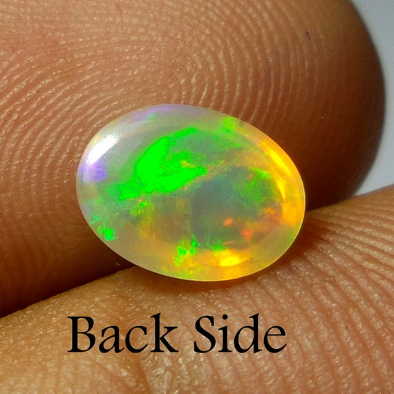1 carat 9.3x7.1x4.1 MM naturel éthiopienne Welo Welo Welo Fire opale ovale forme Cabochon. Ethiopian Opal Cabochon. Multi couleur Cabochon d'opale, opale de feu. cda365