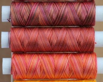Hand Dyed Cotton machine thread, Colour Tequila Sunrise, Red, Orange, Yellow