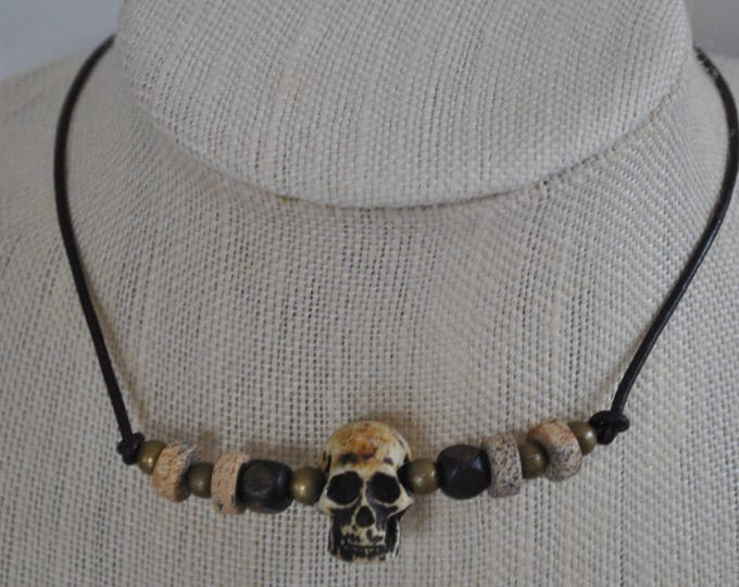 Men's skull necklace on leather, rugged, masculine