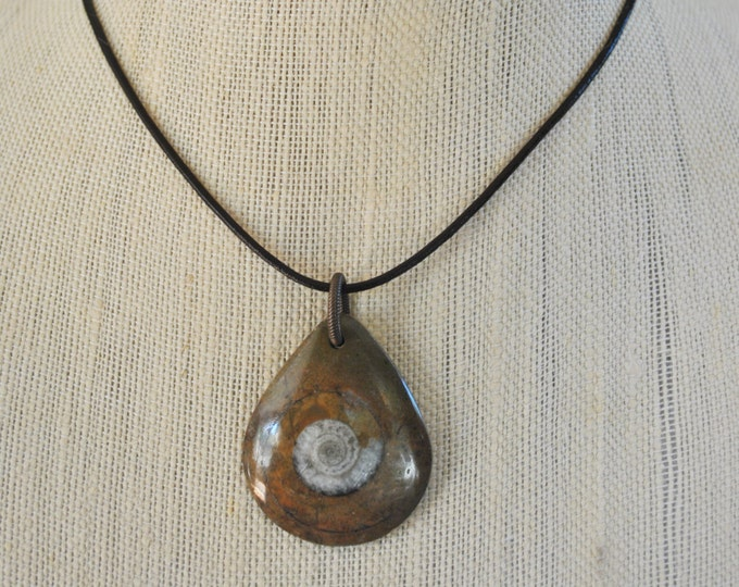 Men's Fossilized and Polished Round Ammonite Necklace on black leather cord with sterling clasp, minimalist, simple