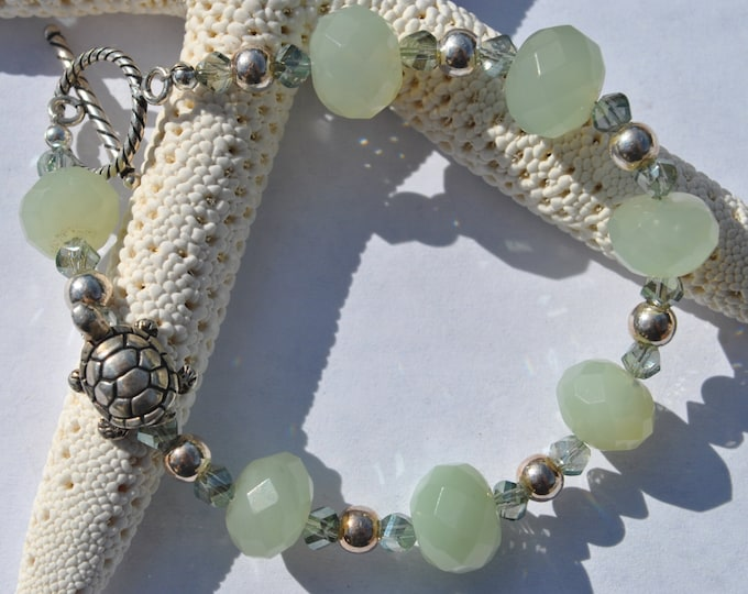 Soft green new jade Turtle bracelet set with green faceted crystals and sterling silver beads and clasp