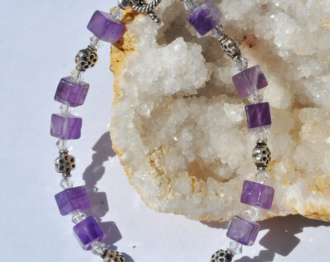 Amethyst Bracelet with clear Swarovski crystals, and sterling silver flower beads