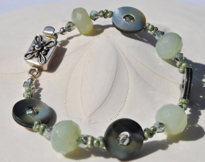 Black lip pearl soft green jade crystals bracelet accented with floral sterling silver clasp