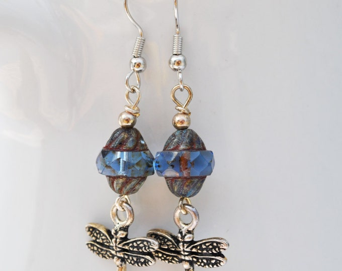 Blue carved turbine Czech glass earrings with silvertone dragonfly dangles