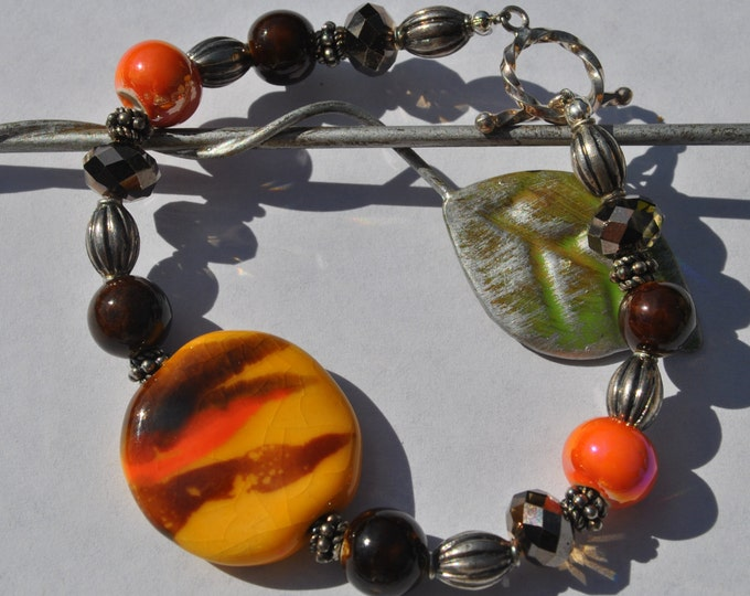 Orange and brown Tiger striped African Kazuri Ceramic bead bracelet with sterling silver Bali beads and bracelet