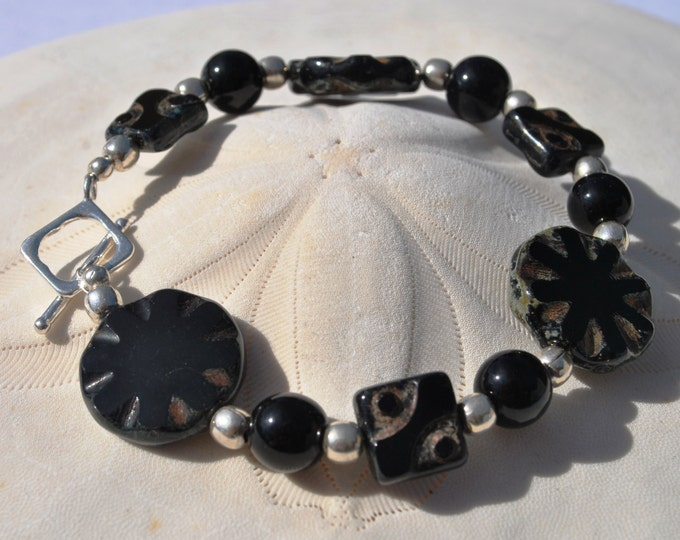 Black Czech glass bracelet set with sterling silver beads and sterling toggle clasp.