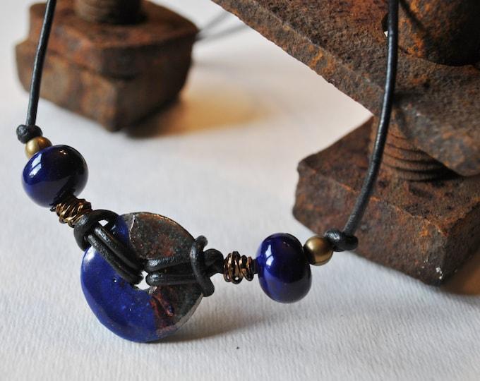 Men's Necklace of cobalt blue Raku ceramic pendant and cobalt blue beads on black leather cord