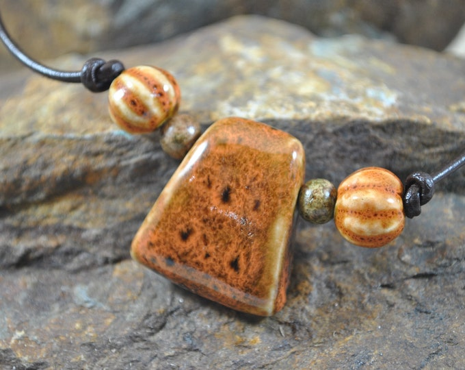 Men's rusty orange ceramic necklace on leather with wooden beads, casual, rugged