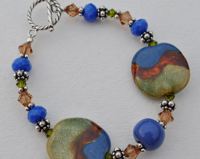 Chunky  Sage, brown, and blue African Kazuri Ceramic bracelet set with Swarovski crystals and Bali sterling silver beads
