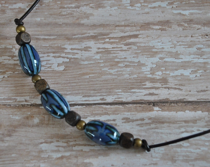 Men's Necklace of cobalt blue ceramic beads on brown leather cord, rugged, masculine