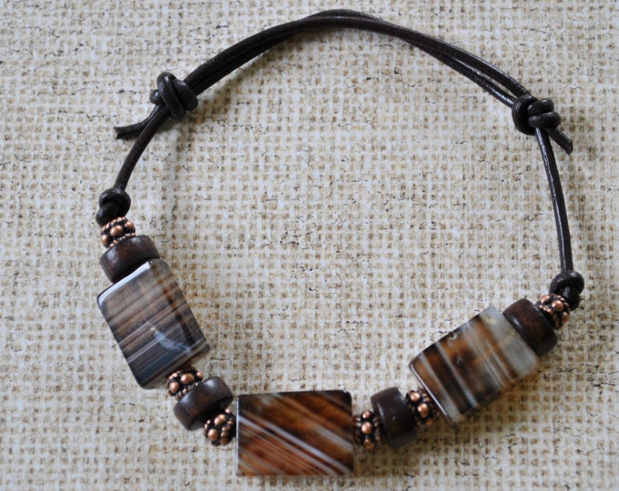 Men's bracelet of black and brown banded agate stone, copper beads on brown leather cord, rugged bracelet, masculine, adjustable