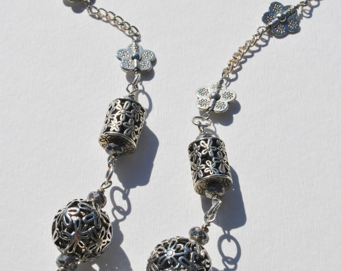 Exquisitely carved floral silver tone beaded necklace