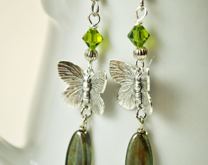 Moss green Czech glass earrings with silvertone butterfly connectors and Swarovski crystals