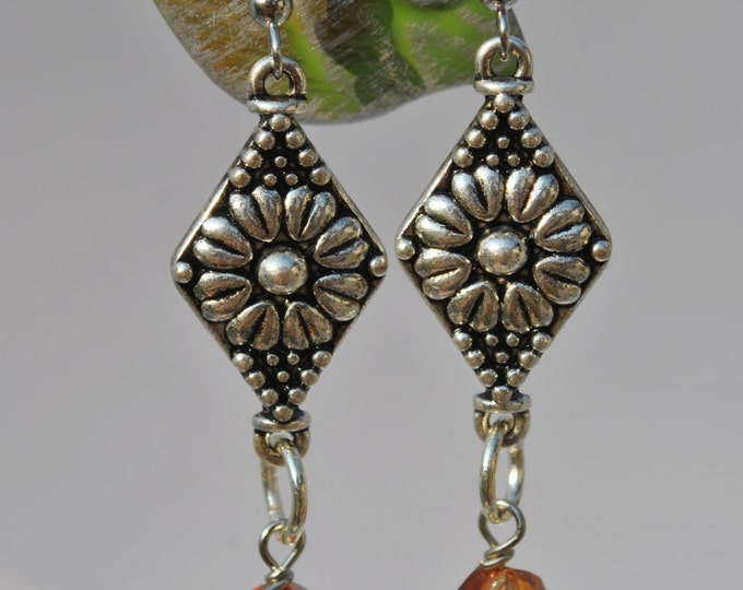 Copper-color crystal earrings with carved floral silvertone connectors