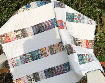 Strikingly original modern patchwork lap quilt in Liberty lawns, suitable for chair,sofa and travel. Washable,practical and original