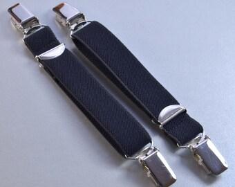 Suspenders with both sides suspender clip, length 25cm, width 2cm in black.