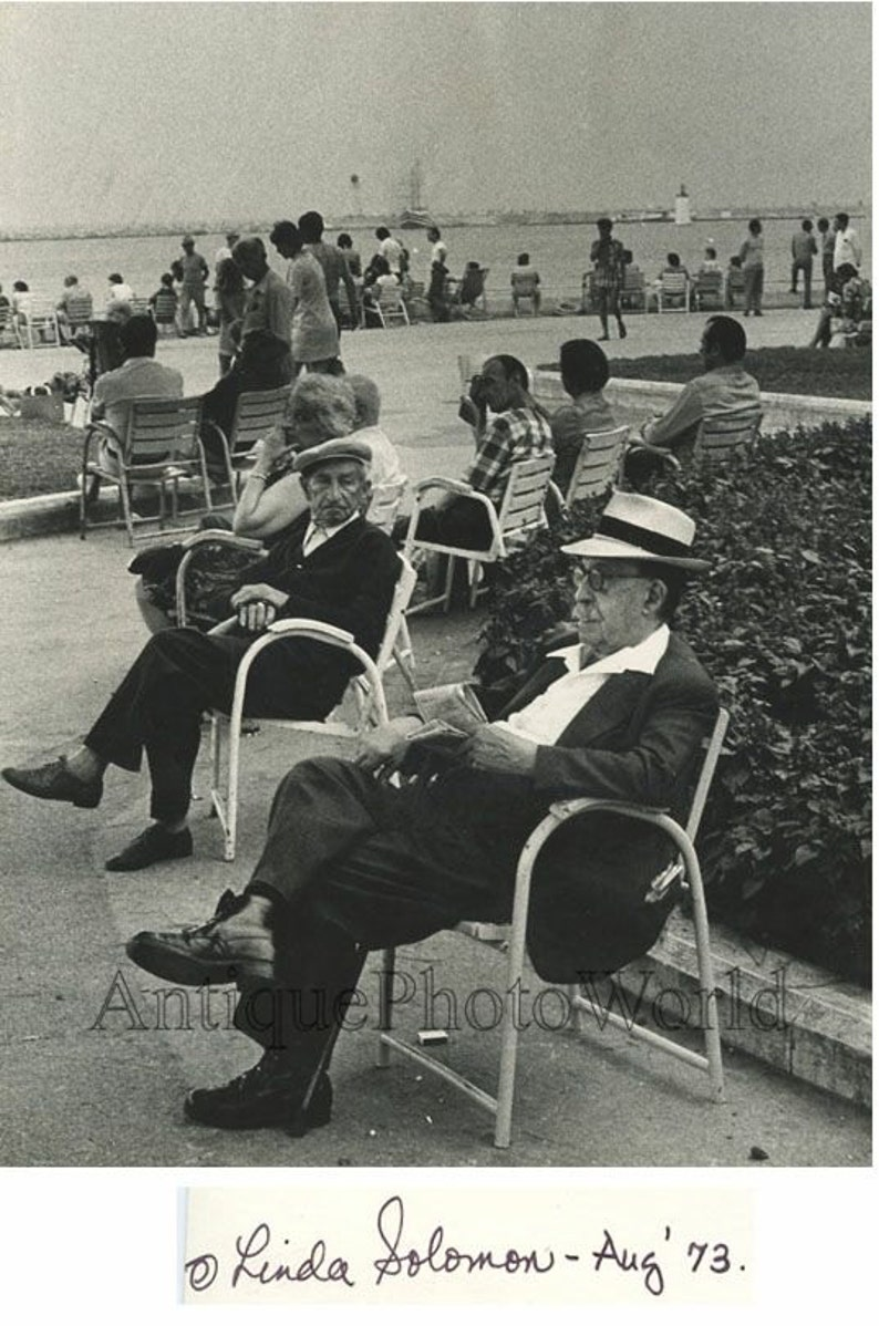 People resting in bay park marina vintage art photo by L Solomon