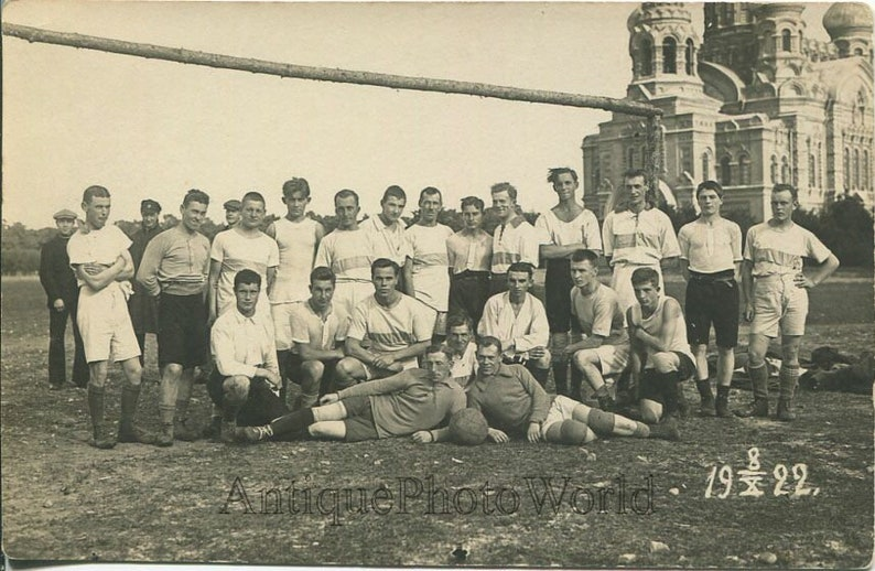 Young men soccer team by Orthodox church antique photo Riga Latvia