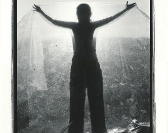 Woman with plastic sheet surreal vintage art photo by Michael Gallant