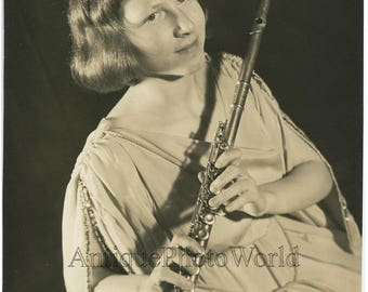 Girl with flute antique music photo