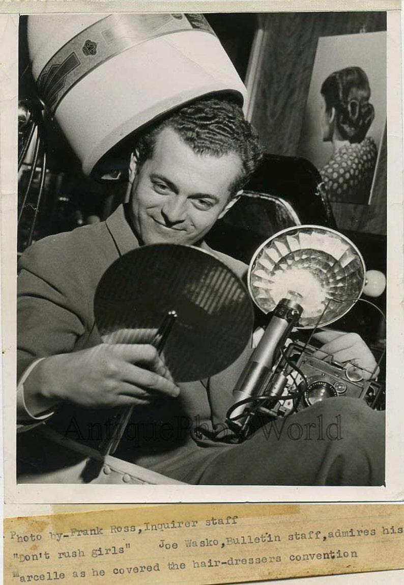 Man w camera at hair dressers vintage photo Frank Ross