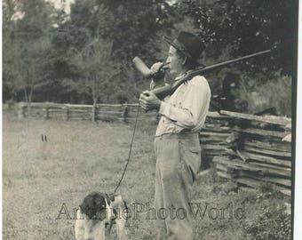 Old man quail hunter w horn rifle and Pointer dog Wayne County Missouri