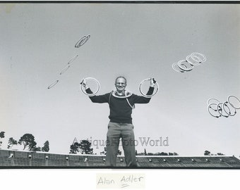 Inventor Alan Adler with flying toys vintage photo