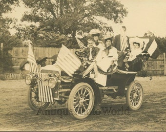 Family in fantastic decorated car parade float US flags antique photo