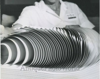 Woman with stack of paper surreal vintage art photo