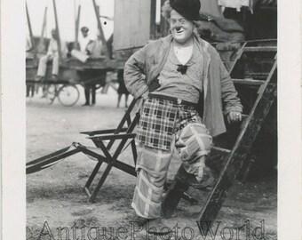 Circus clown by wagon candid antique photo