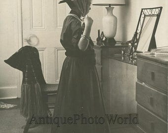 Girl playing dress up by mirror strange vintage art photo by Claire Kofsky