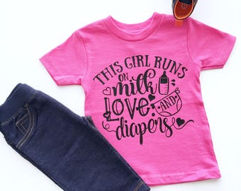 This Girl Runs On Milk Love And Diapers Shirt, Funny Toddler TShirts, Tee Shirts For Toddlers, Girls Graphic Shirts, Trendy Kids Shirts