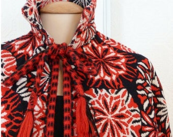 Red, black and white patterns reversible wool cape