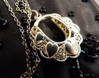 Sterling silver pendant necklace adorned with small hearts