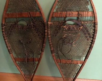 Antique and signed snowshoes