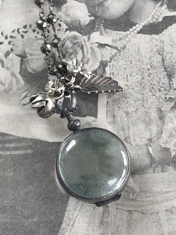 Amelie. Glass locket on pyrite chain with fine silver flower bouquet. Handmade and OOAK by ladeDAH! Jewelry.