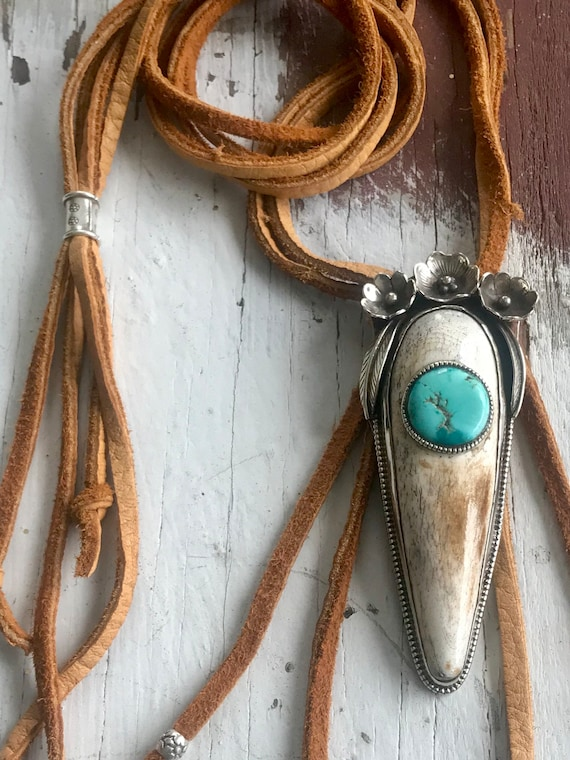 Desert bloom. Amazing bone pendant with turquoise coin and a flower crown hung from 4 strands of soft, thick deerskin. Handmade by ladeDAH!
