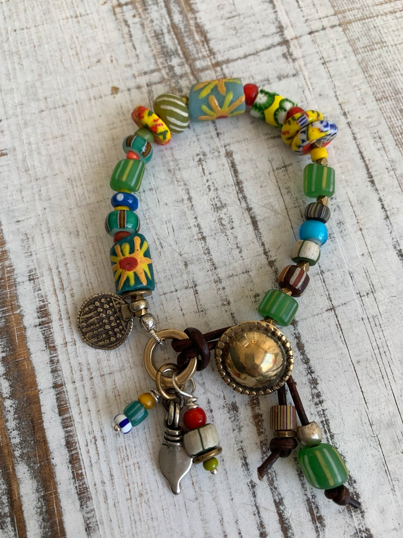 Sun Jewelry. African trade and recycled beads and artisan made button clasp and talisman charms OOAK bracelet by ladeDAH