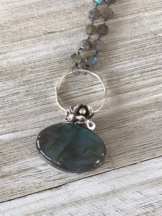 Riverwalk. Oval blue and green labradorite pendant necklace with fine silver flower accents and labradorite chain. Handmade and OOAK by lade