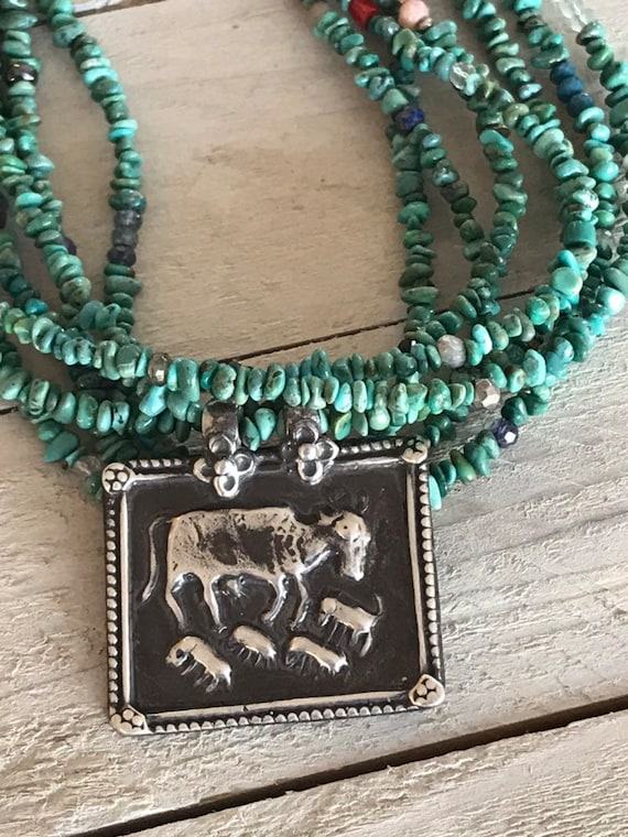 Abundance. Artisan made Tibetan pendant with 7 strands of turquoise and other gems. Adjustable deerskin at back. Handmade and OOAK by ladeDA