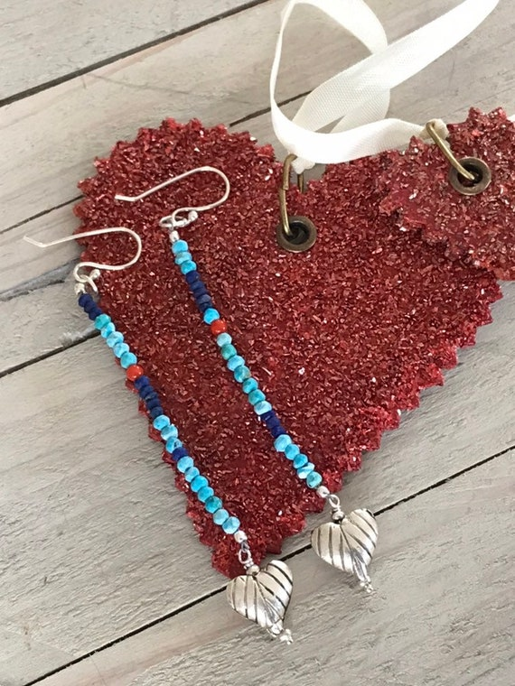 El cariño. Sweet fine silver hearts dangle from a strand of turquoise, coral, amd lapis. Handmade and OOAK. By ladeDAH! Jewelry.