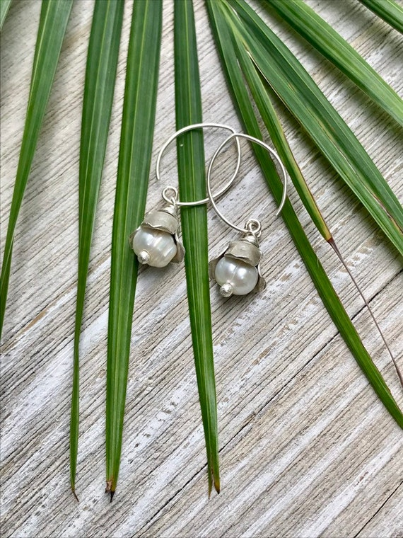 Portia. Fine silver bead cap with white pearl. Sweet and simple flower for your ear. Handmade by ladeDAH! Jewelry.