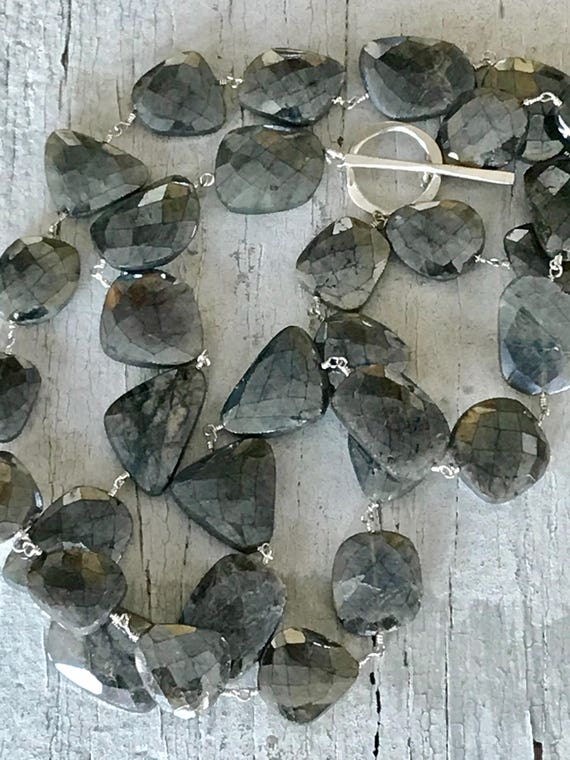 Intuition. Long and chunky labradorite stones wire-wrapped and gathered with a fine silver clasp. By ladedDAH! Jewelry.