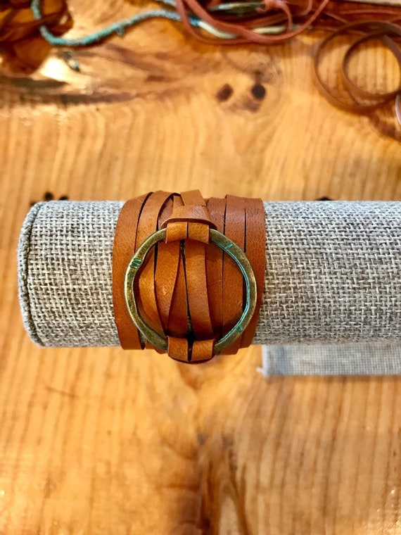 Full circle. Verdigris brass ring and deerskin leather wrap bracelet. Handmade by ladeDAH! Jewelry.