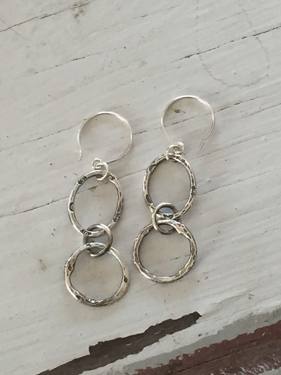 United. Hand forged, stamped, and hammered fine silver earrings. Handmade and one of a kind by ladeDAH! Jewelry.