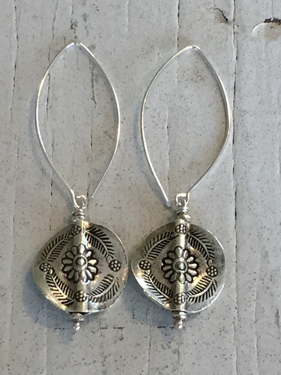 Chaing Mai earring. Hand-stamped flowers and ferns grace these simple coin earrings. Hung from sterling ear wires by ladeDAH! Jewelry.