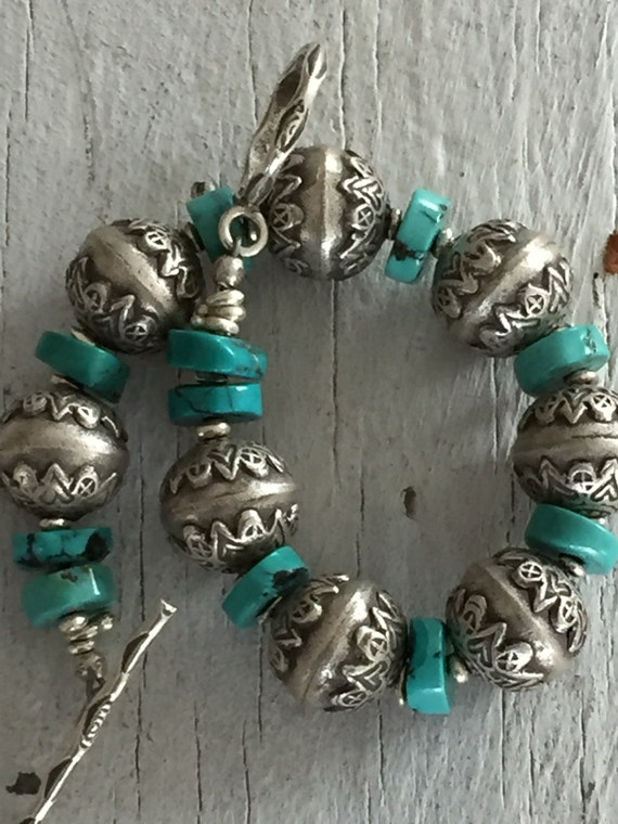 Wandering Heart.   Fine silver rounds with turquoise discs and stamped toggle bracelet. OOAK. Handmade by ladeDAH!