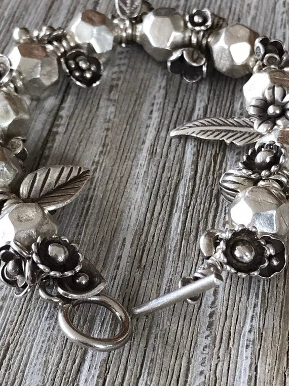 Botanica. Fine silver flowers and leaves among faceted silver beads. Handmade and one-of-a-kind by ladeDAH!